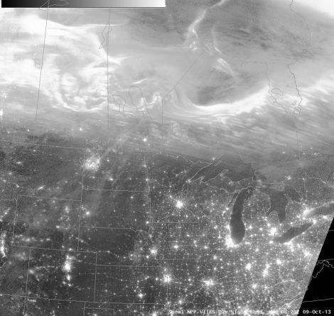 The bright, looping features in the northern half of the picture are the auroras.