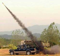 Cloud seeding rockets being fired from the back of pickup truck in China.