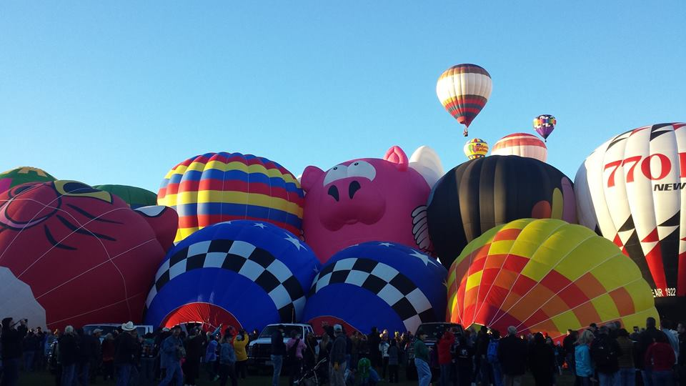 More balloons inflating for takeoff.