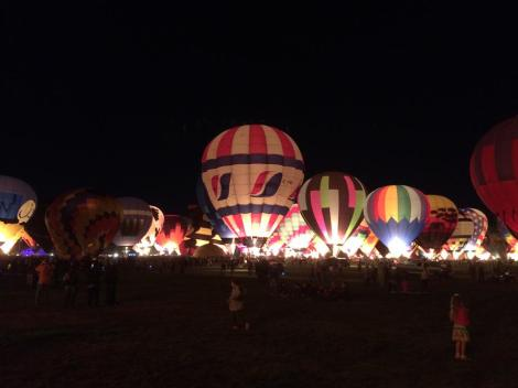 Another great glow picture. The light you see inside the balloons is from the flame used to heat the air.