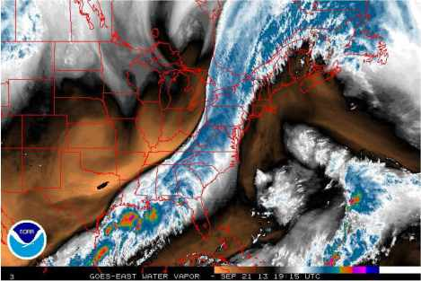 A satellite image for water vapor. Black and orange are drier areas while white and blue are moist.